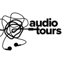 "Ear bud wires with the words ""Audio Tours"""